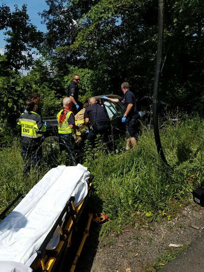 New Canaan emergency responders extricate an occupant from a vehicle that crashed Friday. — New Canaan Fire Department Photo
