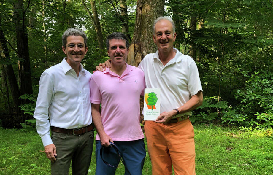 From left, Land Trust board member and Town Council Chairman John Engel, land donor Dr. Bruno DiCosmo, and Land Trust Open Space Committee Chairman Chris Schipper are shown on the new DiCosmo Preserve. — Contributed photo