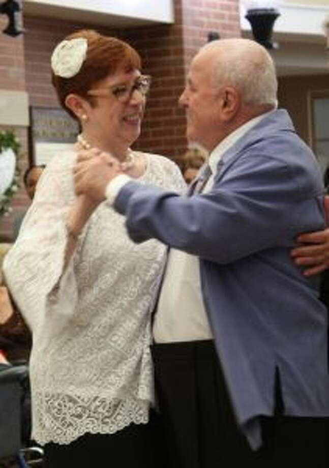 JoAnn Labare and Stefan Antohi dance at their recent wedding renewal celebration at Waveny LifeCare Network. — Contributed photo