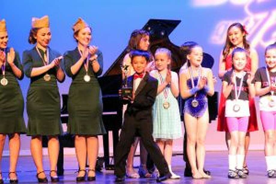 A nine-year-old New Canaan pianist was a top winner of Darien's Got Talent. Cary Wang of New Canaan took the first prize in the children's category at Darien's Got Talent show held June 23 at Darien High School. — Contributed photo