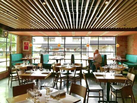 The dining room before the rush at Squable in the Heights