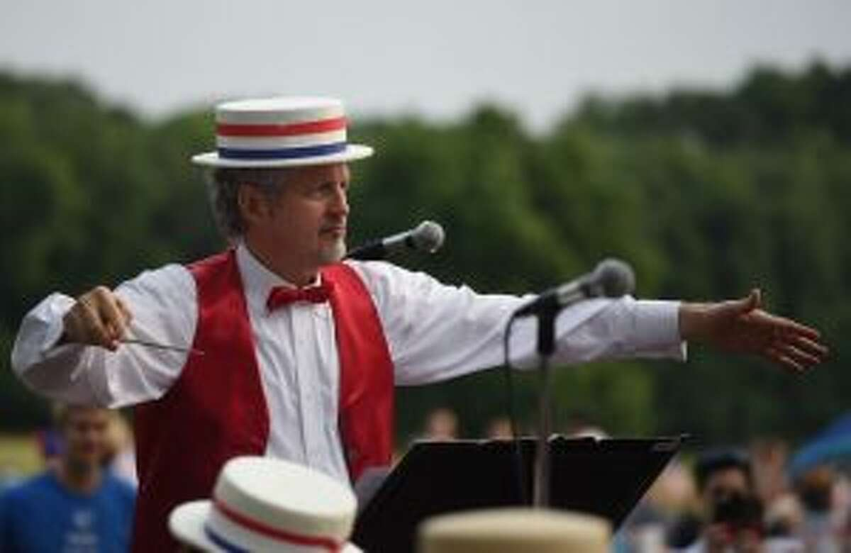 Conductor Brad Williams leads the bands that has a tradition since 1831. - Dave Stewart photo