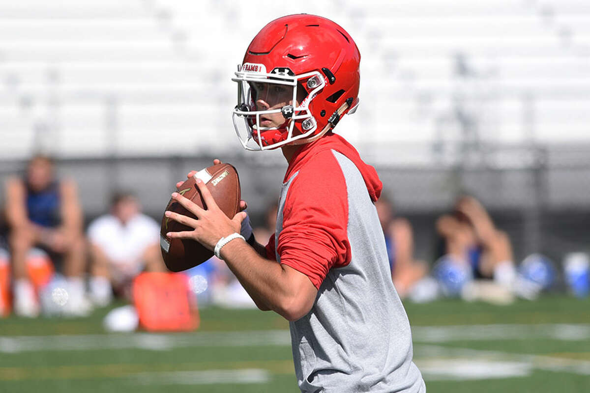 New Canaan quarterback Drew Pyne sets up for a pass during last year's Grip It and Rip It tournament at Dunning Field. - Dave Stewart photo