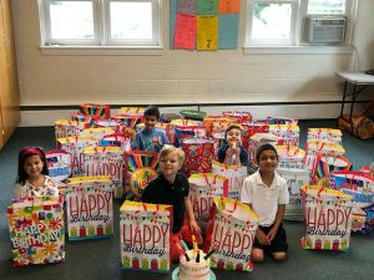 The United Methodist Church of New Canaan put together an effort so 40 kids can enjoy birthday parties. United Methodist Church preschoolers and kindergarten Sunday school children are shown with the party bags from left, Luisa Spremulli, Max Maiya, James Henry, Pierce Reeves and and Vir Maiya. - Contributed photo