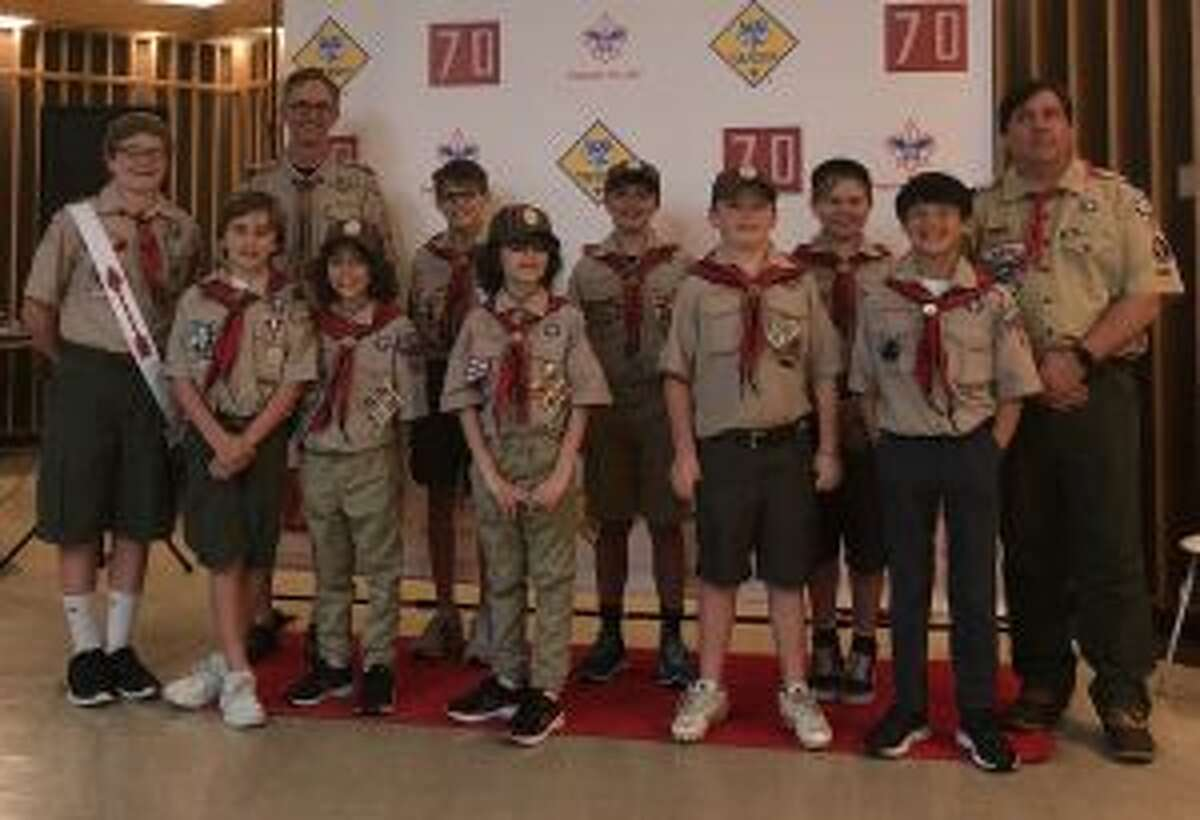 New Canaan Cub Scout Pack 70 see the honor in Arrow of Light recipients. The Senior Webelos scouts who received the Arrow of Light, from left to right, are, front row, from left, Jack Winalski, Aidan Taylor, Lucas Taylor, Henry Stimpson, and Ryan Leahy; back row, from left, William Winalski, Crossover representative of Troop 70 and den chief; Chris Winalski, den leader; Teddy Broder, Lachlan Ivaneza, Harry Cullen, and John Stimpson, assistant den leader and Pack 70 Committee chair. In addition, Ryan Little received the Arrow of Light. - Contributed photo
