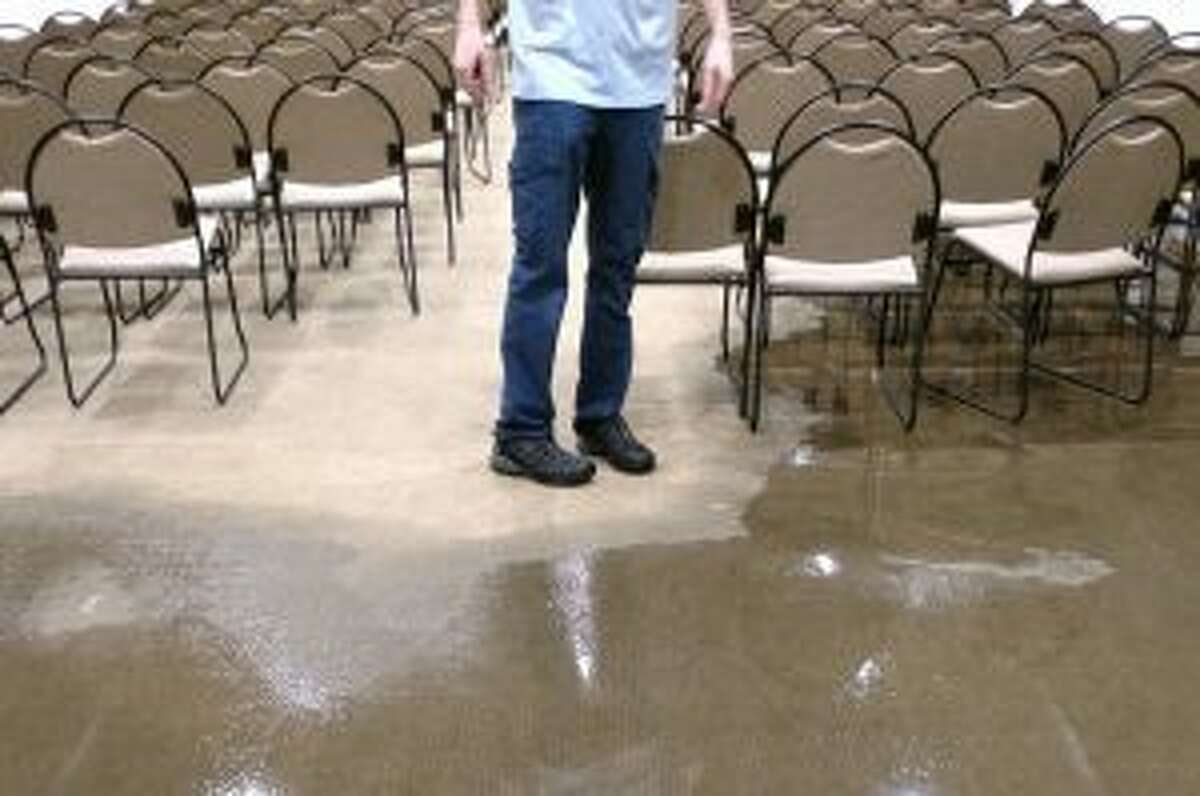 It got worse in the New Canaan Library Lamb Room after this picture was taken. Water soon covered the entire floor. Activities in the room will be relocated to other spaces in the library for the foreseeable future or possibly postponed if need be. - Contributed photo
