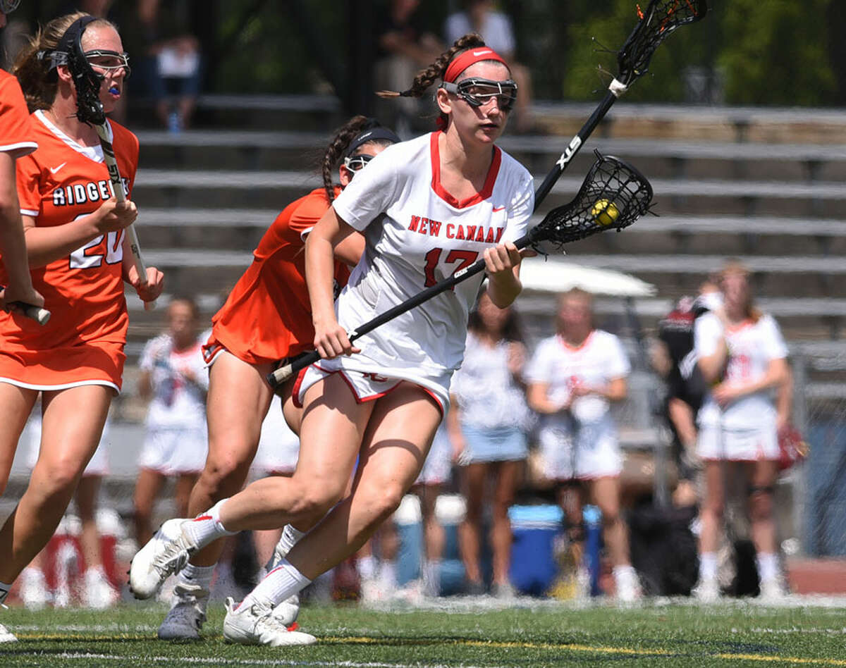 New Canaan Sikorski Award winner Julia Ozimek controls the ball during the Rams' 19-7 victory over Ridgefield in the Class L championship game earlier this month. - Dave Stewart photo