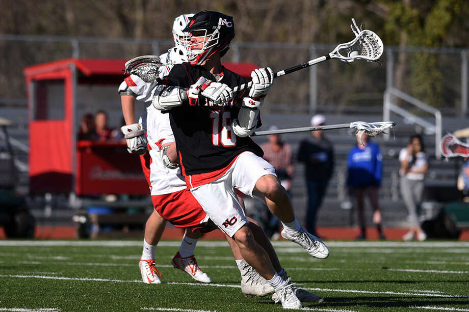 New Canaan's Mac Deane unleashes a shot during a victory over Greenwich. — Dave Stewart photo