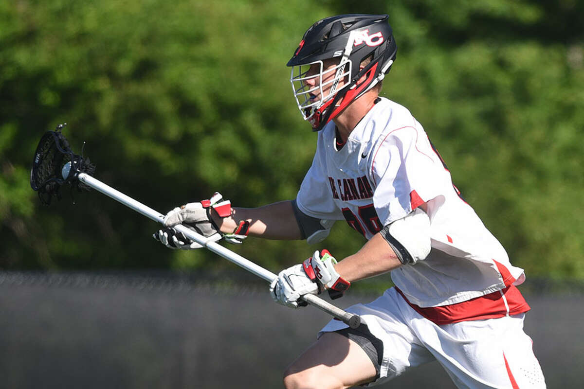 Co-captain Chase Strupp clears out of the defensive zone during the Rams' win over Fairfield Prep in the Class L quarterfinals. - Dave Stewart photo