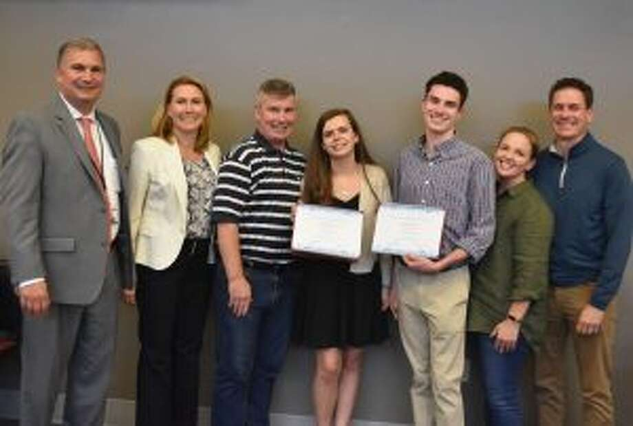 New Canaan High School seniors recently received of awards from the state board of ed. From left, New Canaan Public Schools Superintendent of Schools Dr. Bryan Luizzi, Board of Education Chair Dionna Carlson, Kevin Buckley, his daughter CABE Award winner Olivia Buckley, CABE Award winner Will Dooley, and his parents Jessica Finck-Dooley and Christopher Dooley. — Contributed photo