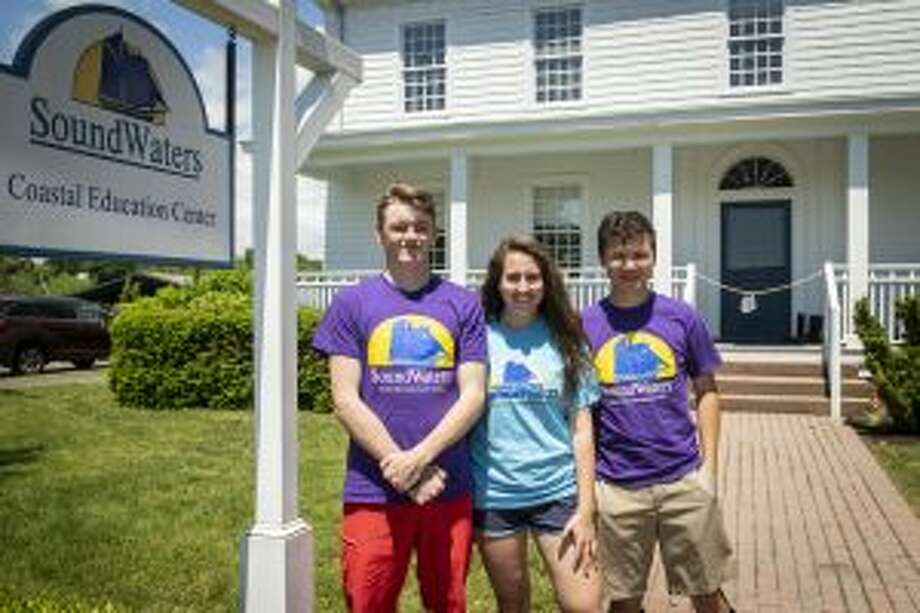 SoundWaters recently welcomed interns from New Canaan High School for a spring internship. These New Canaan High School seniors take a break between teaching classes at SoundWaters at Cove Island Park in Stamford, from left, Dylan Wietfeldt, Martina Raooslavov, and Evan Reilly. — Contributed photo