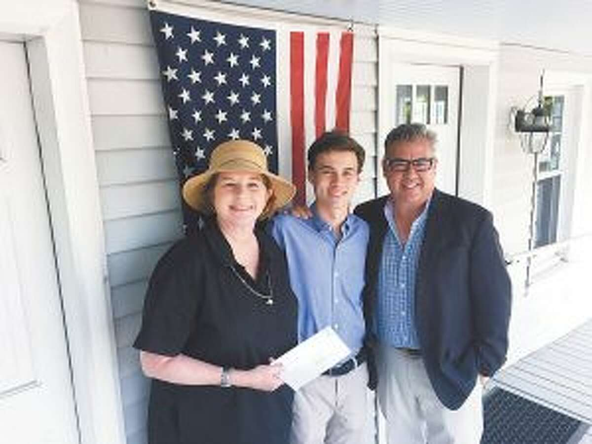 New Canaan resident Jack Dunn is a Connecticut Realtors Foundation 2018 Raymond F. Gates, Jr. Memorial Scholarship recipient. From left are New Canaan Board of Realtors President Janis Hennessy, scholarship winner Jack Dunn and his father, Realtor John Dunn. - Contributed photo