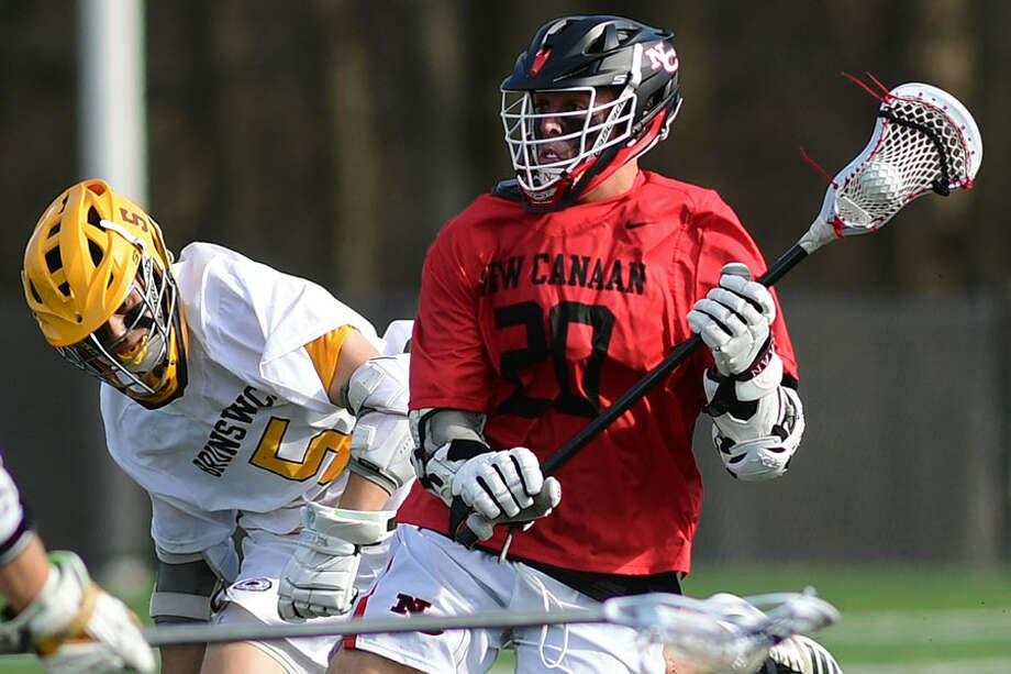 New Canaan senior co-captain Quintin O'Connell, shown in action against Brunswick on April 13, scored five goals during a 12-4 win over St. Joseph on Saturday. — Erik Trautmann/Hearst Connecticut Media / Norwalk Hour