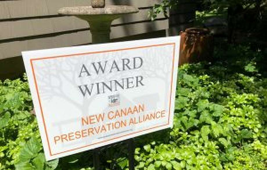 The New Canaan Preservation Alliance recently recognized seven honorees at an awards celebration. New Canaan Preservation Alliance award winner sign. — Contributed photo