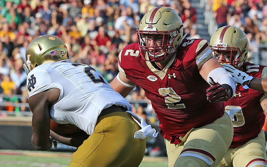 New Canaan's Zach Allen (2) in action for the Boston College football team. Allen had a spectacular season in 2017 and opted to forgo the NFL Draft and stay at BC for his senior season. — Boston College Athletics photos