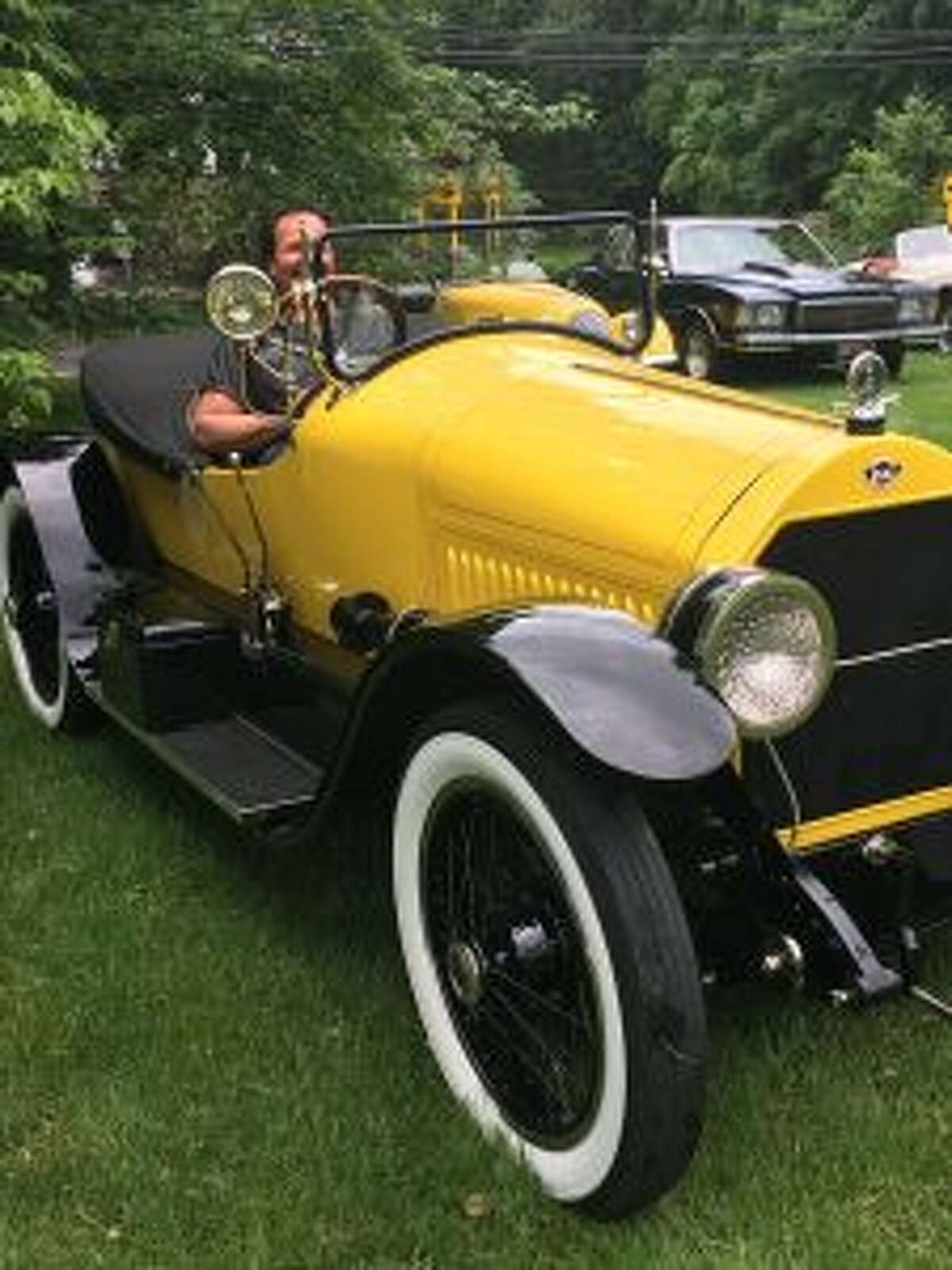George Dragone sits in the 1920 Stutz Bearcat which won an award at New Canaan Historical Society's Ice Cream Social. - Contributed photo