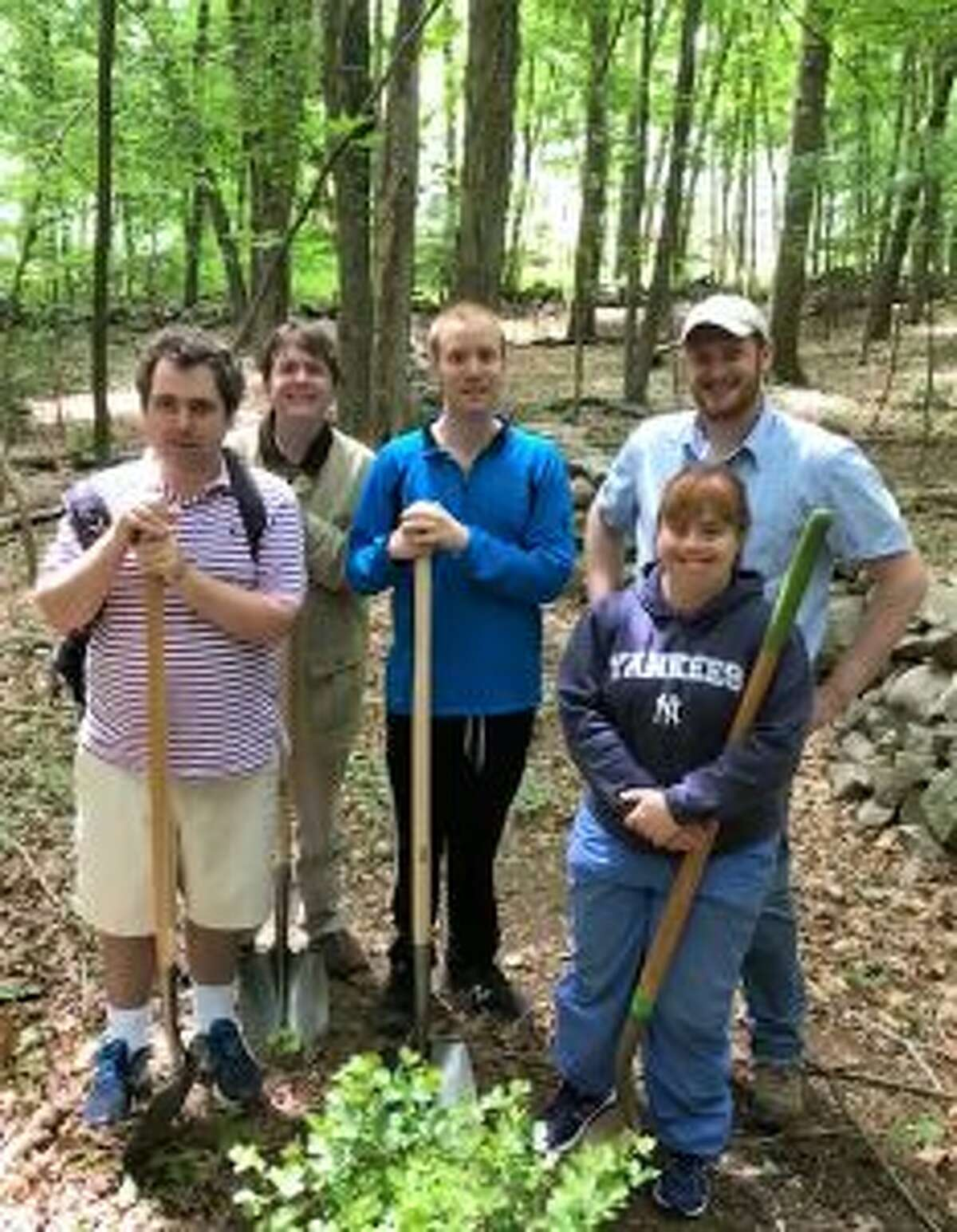 The New Canaan Land Trust, and a STAR partner is going to protect open space. STAR clients, from left, Nick Evarts, Todd McInerney, Bjorn Swarting; Aaron Lefland, executive director, New Canaan Land Trust and client Nicki Dubiago. - Contributed photo