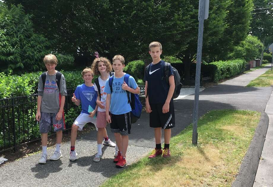 Heading up South Avenue to the village midday Friday were, from left, Will Durfee, Colin Perkins, William Larson, Jack Timlen, and Nicholas Limone. — Greg Reilly photo