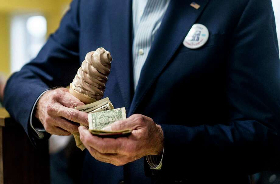 Biden pays for an ice cream cone at The Cone Shoppe in Monticello, Iowa, on April 30, 2019, on his first swing through Iowa as a Democratic presidential candidate. Photo: Washington Post Photo By Melina Mara / The Washington Post