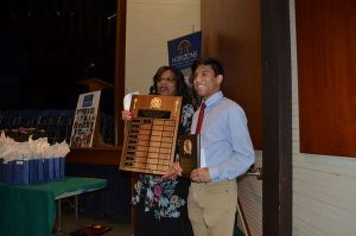 Graduate Jude Infante being awarded the Jackie Robinson Valedictorian Award - Luca Triant photo