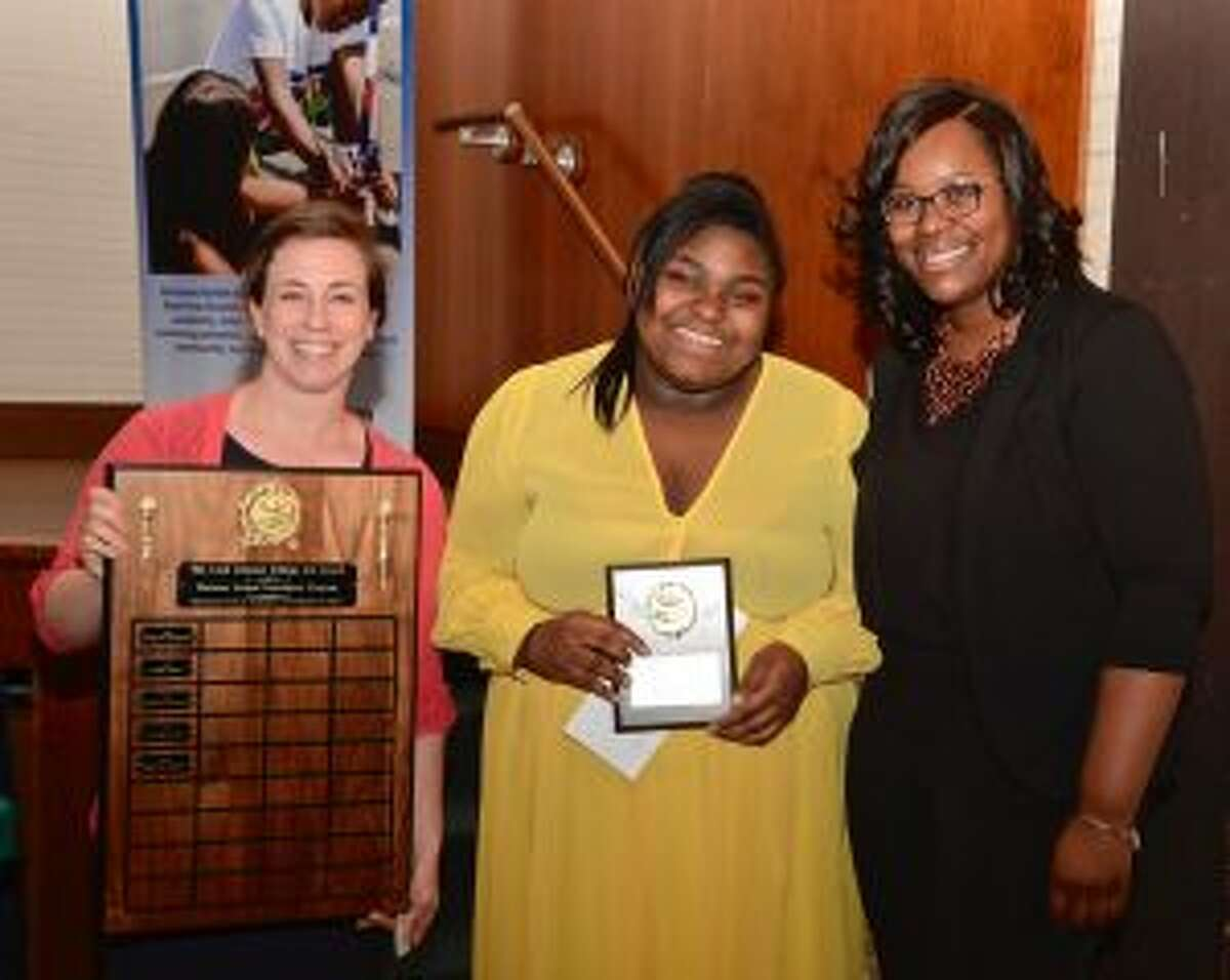 Graduate Nikayla Ashley being awarded the Leah Kimmet College Aid Award - Contributed photo