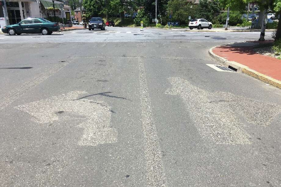 The directional arrows are barely visible where the paint had been scraped off on Cherry Street at the Pine Street intersection looking west. — Greg Reilly photo