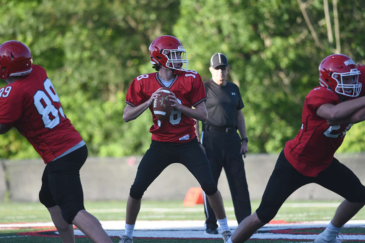 New Canaan sophomore QB Christian Sweeney looks downfield for a receiver during the Rams' annual spring football game at Dunning Field last Friday. - Dave Stewart photo