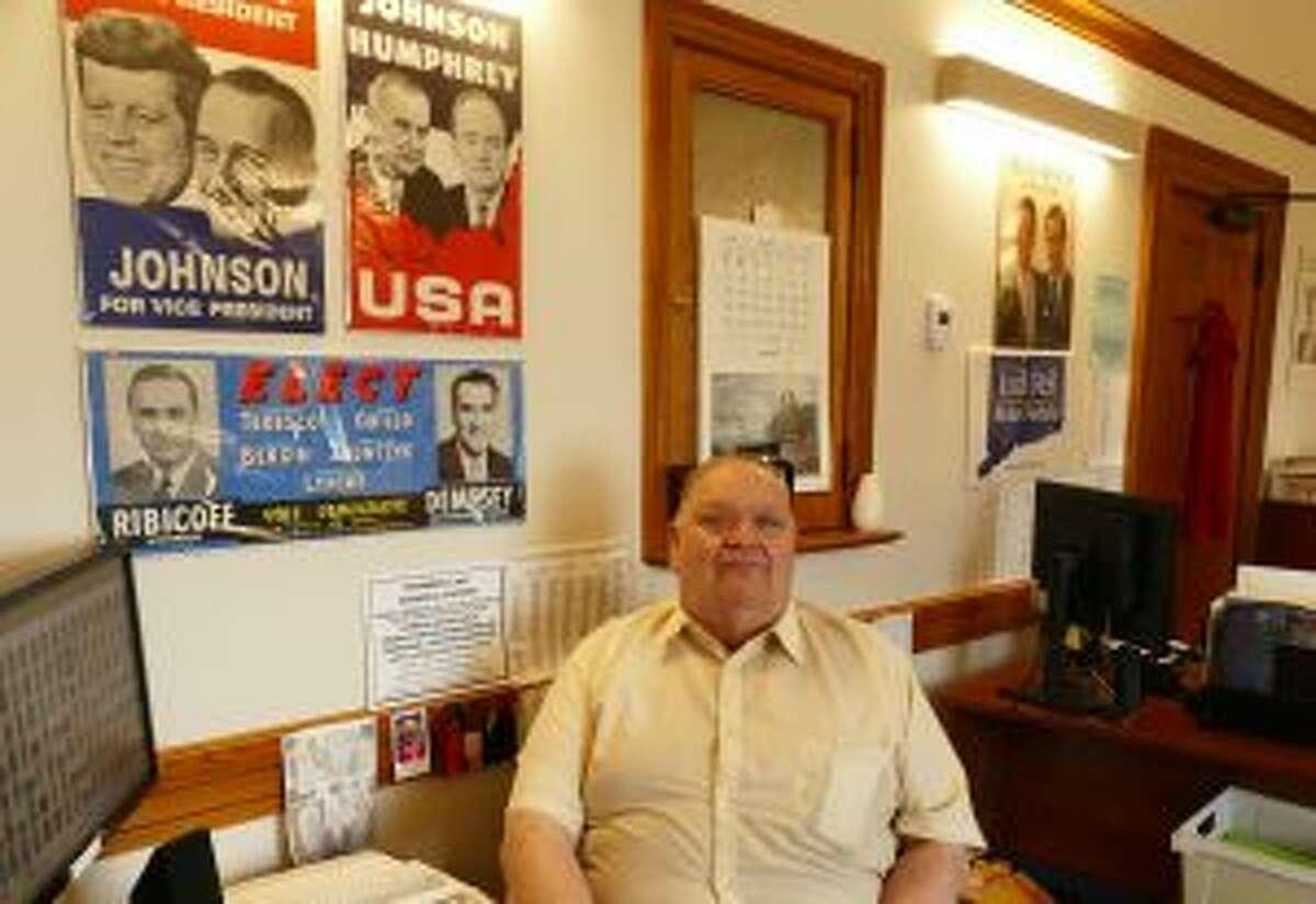 Registrar George Cody collects political memorabilia. - Grace Duffield photo