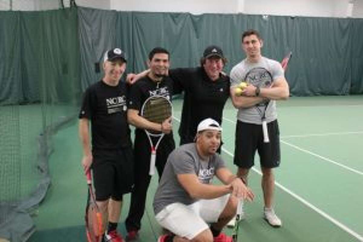 Tennis pros participate in an April 20 New Canaan Racquet Club Tennis Exhibition. - Contributed photo