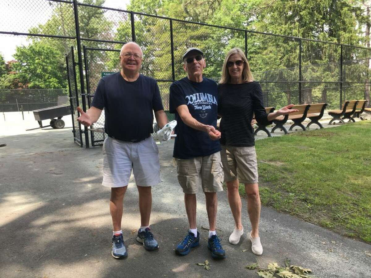 Three tennis players at the Mead Park tennis courts on Friday afternoon, June 8, hold out their hands to say 'why aren't the courts open for play?' - Greg Reilly