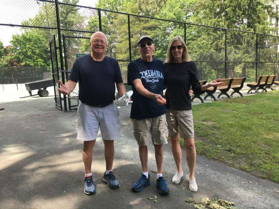 Three tennis players at the Mead Park tennis courts on Friday afternoon, June 8, hold out their hands to say 'why aren't the courts open for play?' — Greg Reilly