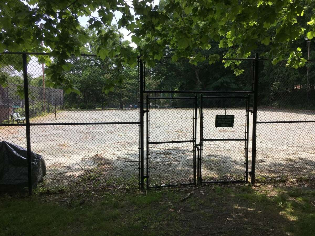 At least four of the Mead Park tennis courts look like this - sticks, leaves, no net and locked door. - Greg Reilly photo