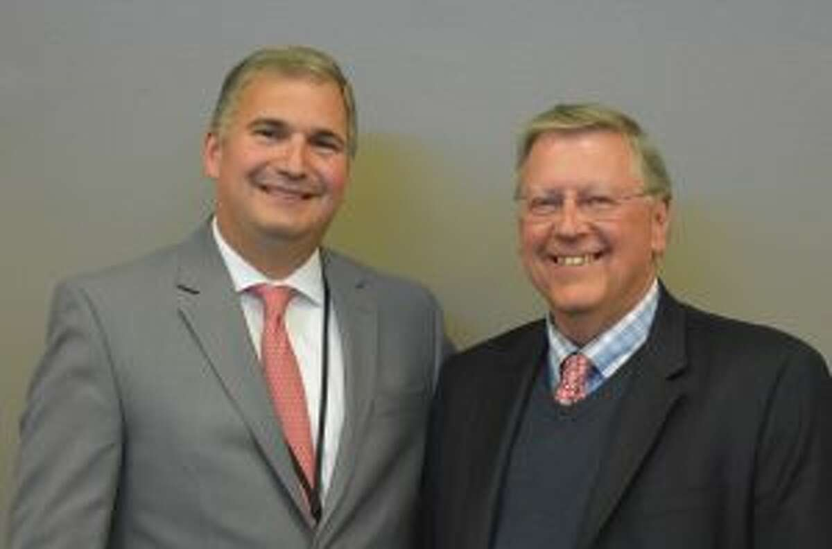 New Canaan: The Board of Education recently recognized a retiring principal, and teachers. Bryan Luizzi, New Canaan Public Schools superintendent, left, shown with Greg Macedo, who is retiring after serving 25 years as Saxe Middle School principal. - Contributed photo