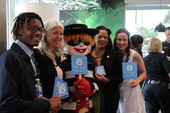 Safe 2 Save CEO Marci Corry (right) poses with Jacqueline Fortune, director of community engagement for Harris County Sheriff's Office (center right), The Hamburgler, Karla Cisneros, Houston City Council member, and HSCO intern Jamal Jolivet (left) during the event announcing McDonald's partnering with Safe 2 Save.