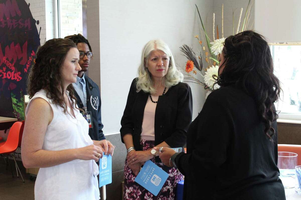 Safe 2 Save CEO Marci Corry (left) speaks with Karla Cisneros, Houston City Council member (center), and Jacqueline Fortune, director of community engagement for Harris County Sheriff's Office during the event announcing McDonald's partnering with Safe 2 Save.