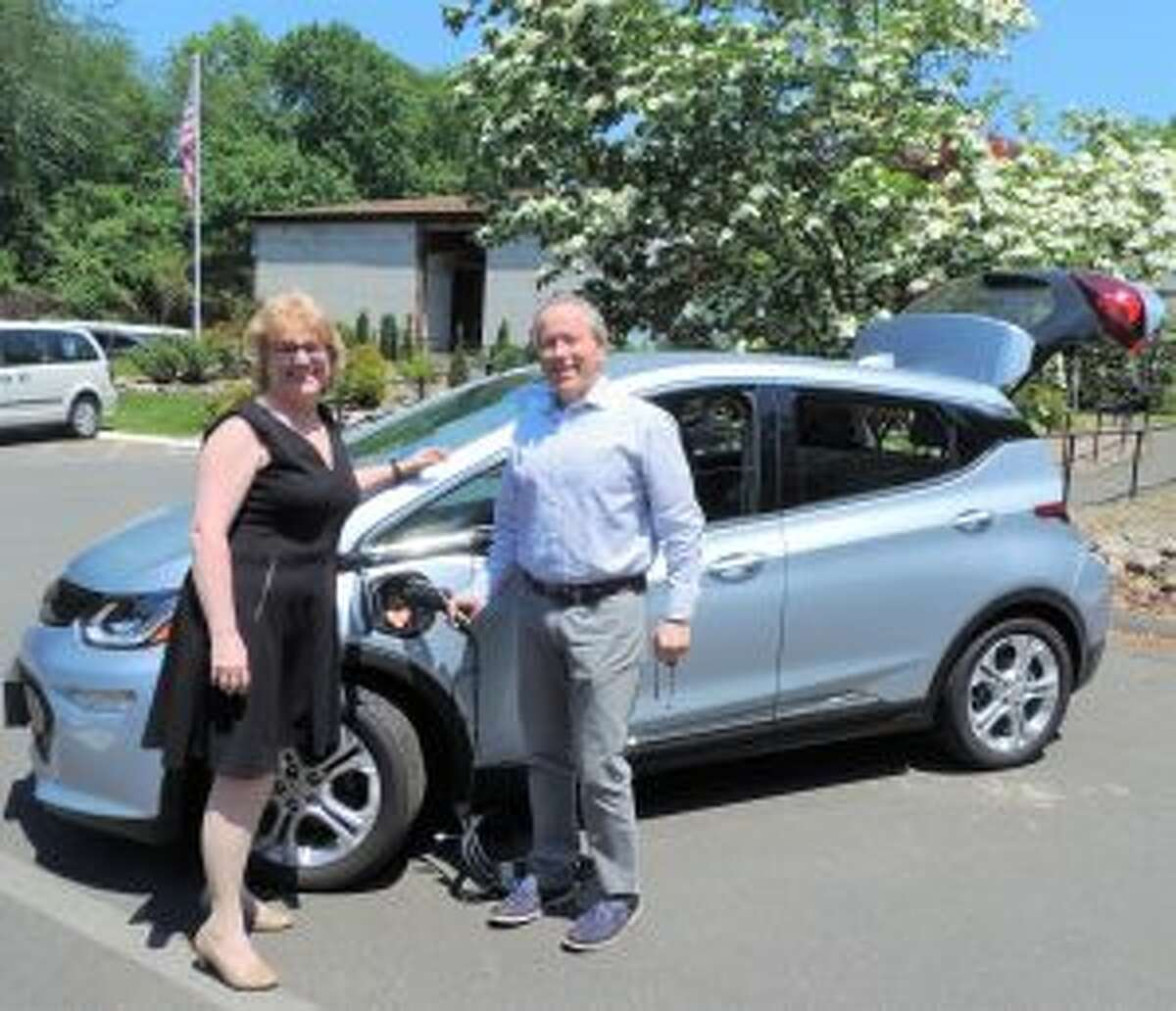 New Canaan: STAR's new electric car are among steps to leverage resources. Katie Banzhaf, executive director, STAR, Inc., left, and Leo Karl, III, president of Karl Chevrolet, are shown with the car. - Contributed photo