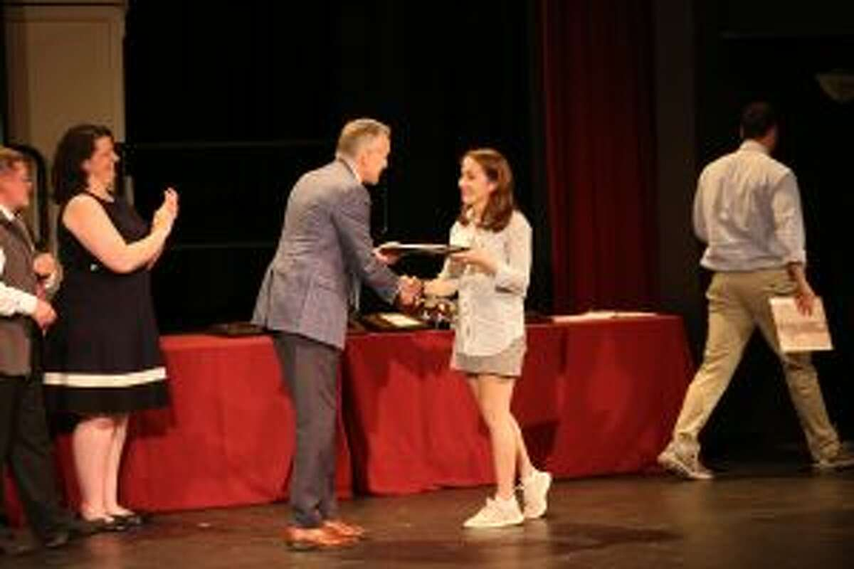 The Upper School at St. Luke's in New Canaan recently awarded students for their contributions. St. Luke's Head of School Mark Davis of New Canaan presents the Whitcomb Award to Claire Wilson, also of New Canaan. - Photo by Desiree Smock