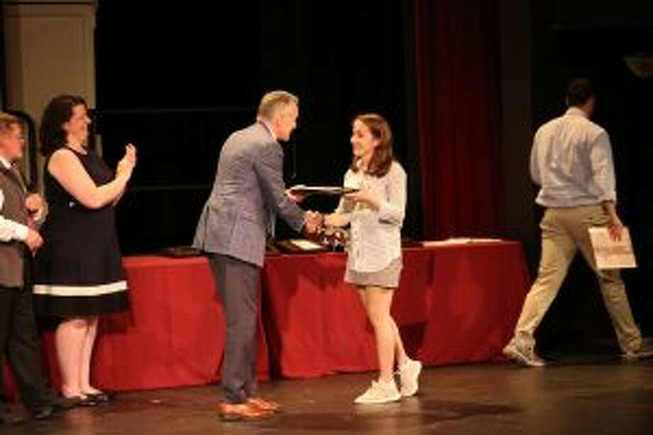 The Upper School at St. Luke's in New Canaan recently awarded students for their contributions. St. Luke's Head of School Mark Davis of New Canaan presents the Whitcomb Award to Claire Wilson, also of New Canaan. — Photo by Desiree Smock