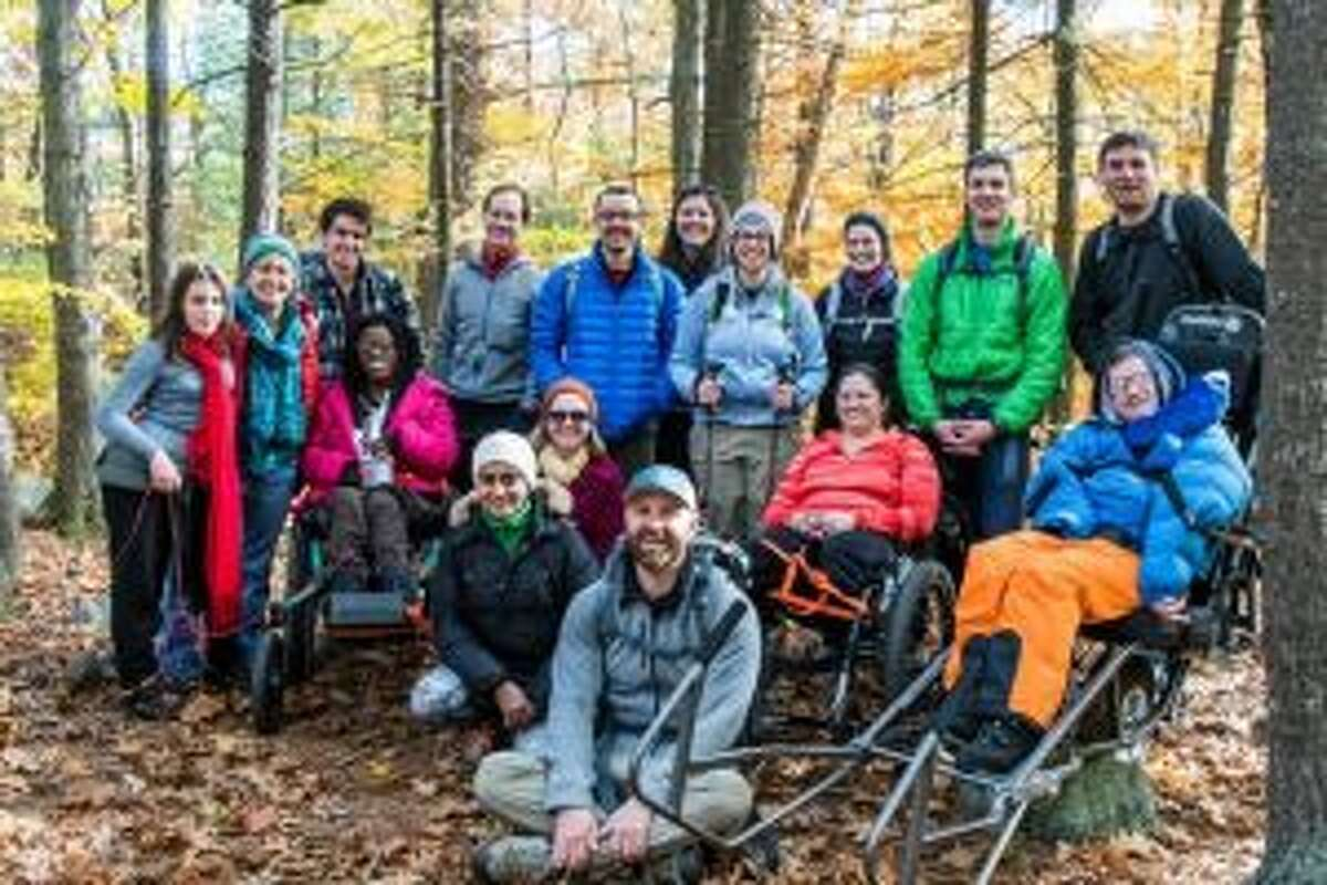 A volunteer and class participants on an autumn hike. - Contributed photo