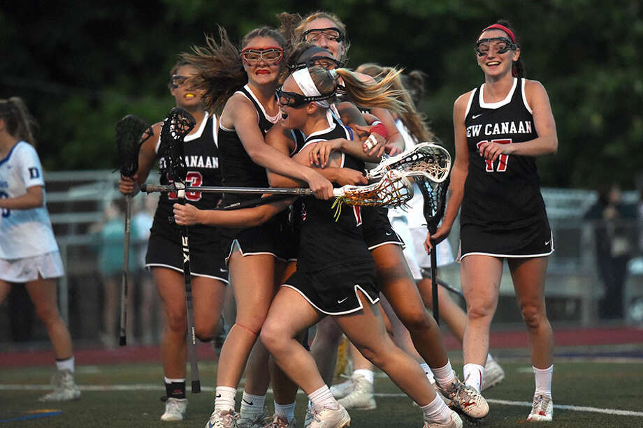 New Canaan celebrates a second-half goal during a 12-11 win over rival Darien in the CIAC Class L girls lacrosse semifinals Tuesday at Brien McMahon HS. — Dave Stewart photo