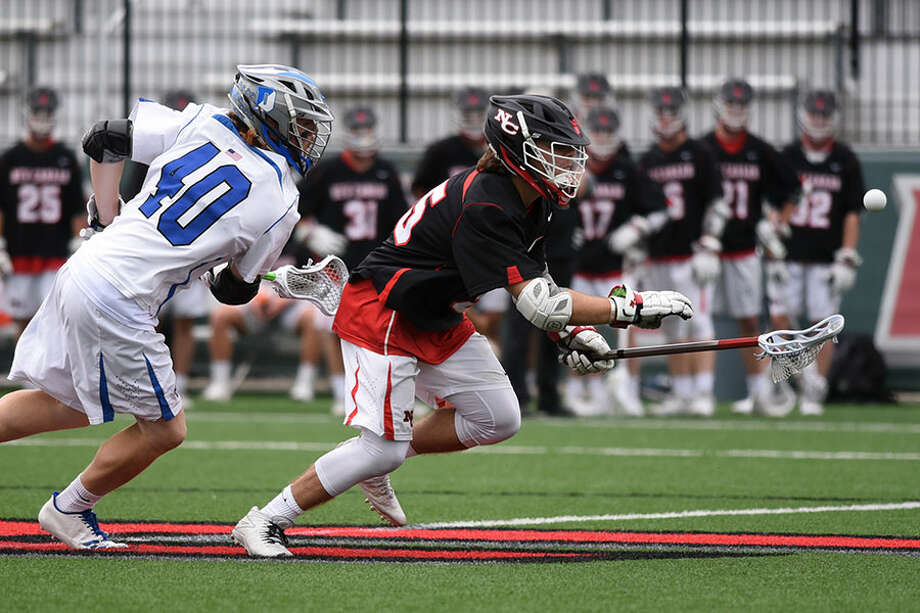 New Canaan's Nick Crovatto wins a faceoff during the CIAC Class L semifinals Wednesday in Fairfield. — Dave Stewart photo