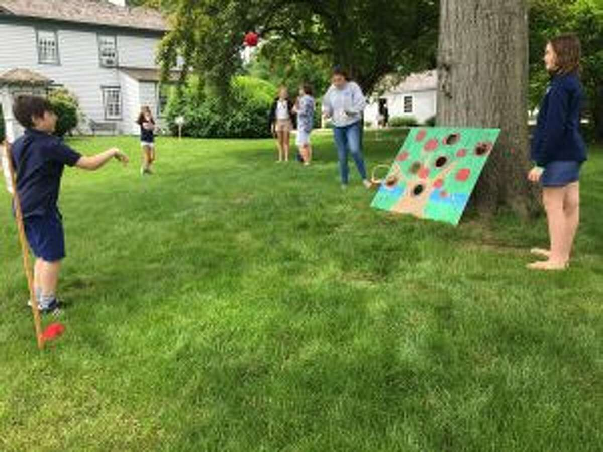 There were multiple 'old fashioned games' scattered around the property, including tossing, and needle in a haystack. - Luca Triant photo