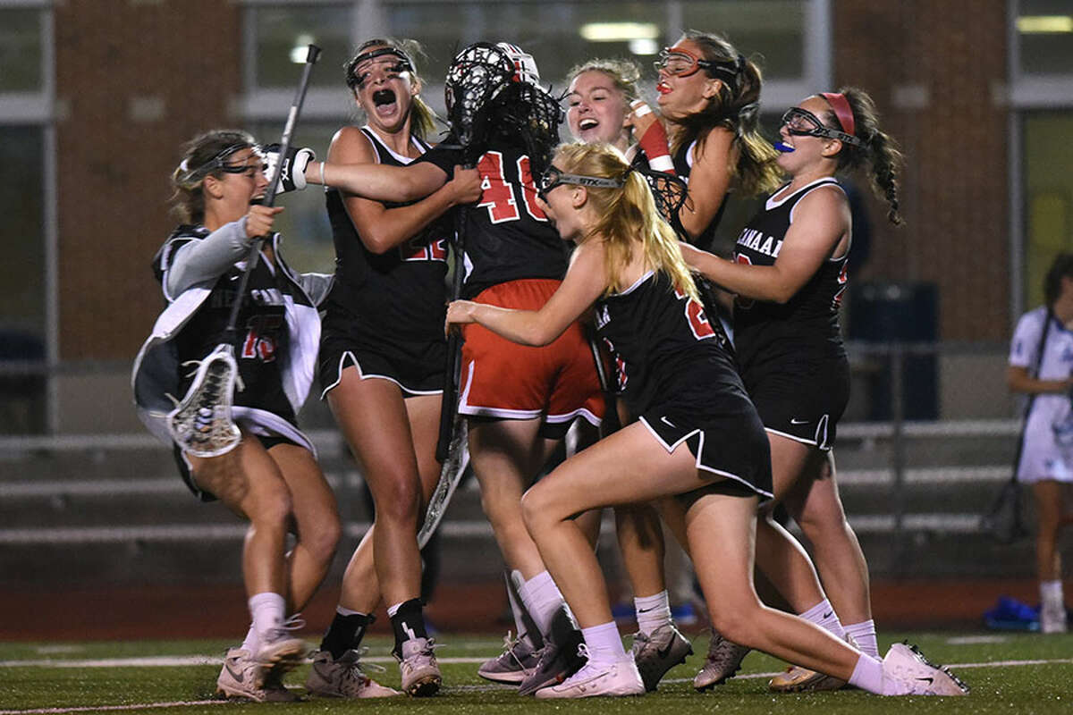 The New Canaan Rams mob goalie Caroline O'Dea after defeating the Darien Blue Wave, 12-11, in the 2018 CIAC Class L semifinals at Brien McMahon HS. - Dave Stewart photo