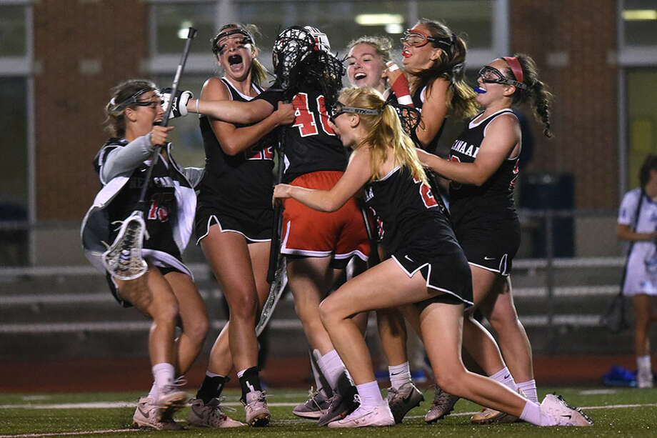 The New Canaan Rams mob goalie Caroline O'Dea after defeating the Darien Blue Wave, 12-11, in the 2018 CIAC Class L semifinals at Brien McMahon HS. — Dave Stewart photo