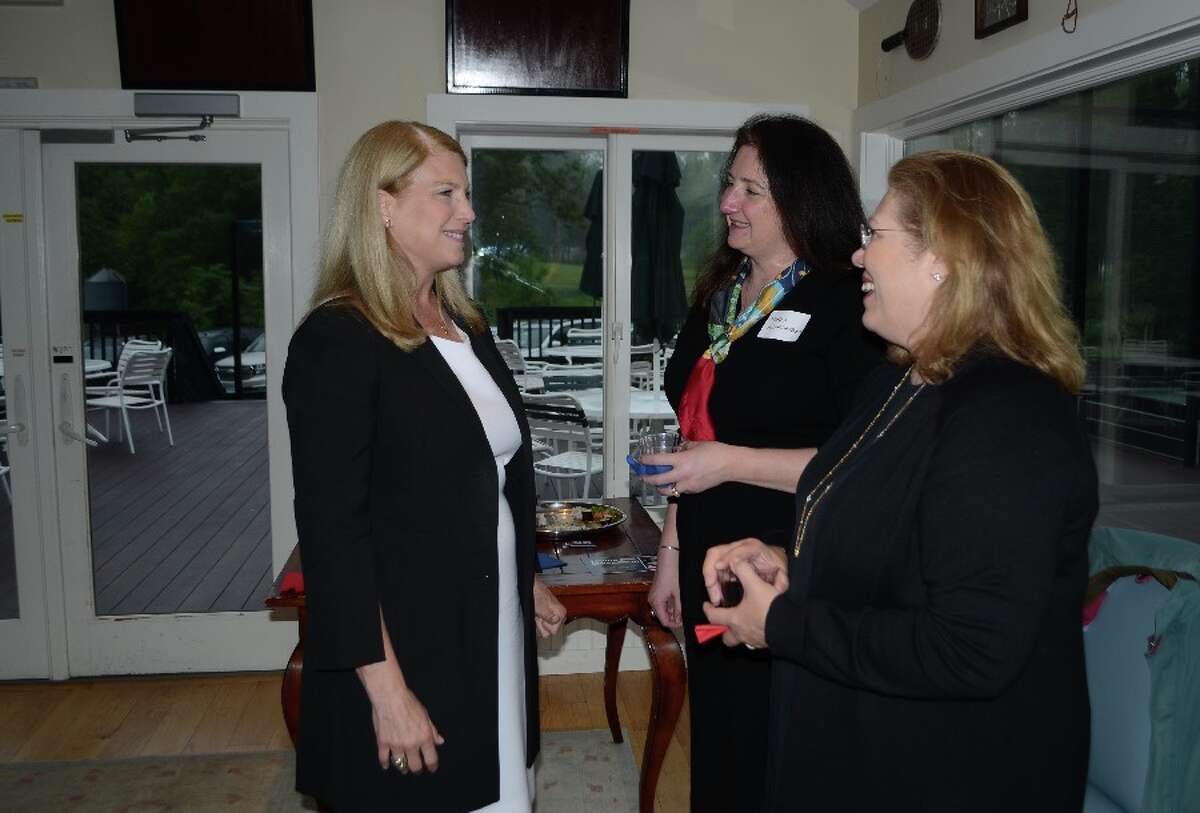 Jayme Stevenson, Darien First Selectman and candidate for lieutenant governor, at left, in the Country Club of New Canaan's paddle tennis hut on May 31 for a meet-and-greet. With her were New Canaan RTC member Maria Weingarten, center, and New Canaan Town Council member Cristina Ross. - Greg Reilly photo