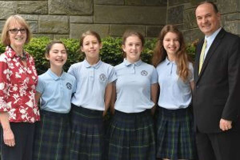 From left, Deborah Phillips, Upper School science teacher at St. Aloysius School smiles for her sixth graders Bernadette McNamara, Sophia Brauweiler, Natasha Lilly, Kelly Dunne and Principal Bardhyl Gjoka. — Contributed photo
