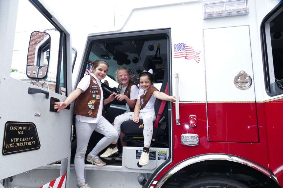 "Brooke Garcia, 10, Charlotte Hanover, 10, and Evelyn Garcia 8, thought the new fire truck, Engine #7, was ""amazing"" and ""cool."" — Grace Duffield photo"