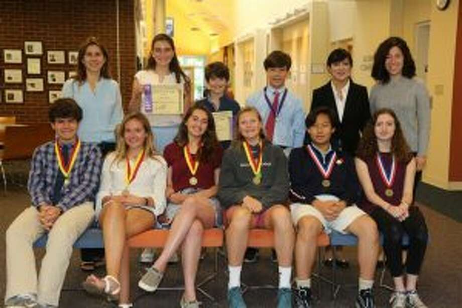 New Canaan Country School students recently had a strong world language showing. New Canaan Country School students who earned national recognition in the 2018 World Language exams included, front row from left, Shane Carbin of Norwalk, Hannah Nightingale of Rowayton, Georgia Rivero of New Canaan, Ellie Hanson of New Canaan, Seth Yoo of Pound Ridge, N.Y., and Alexandra Mathews of Stamford; back row from left, Sofie Petricone of Rowayton, Mac Ryan of Pound Ridge and Cody Comyns of New Canaan. — Contributed photo