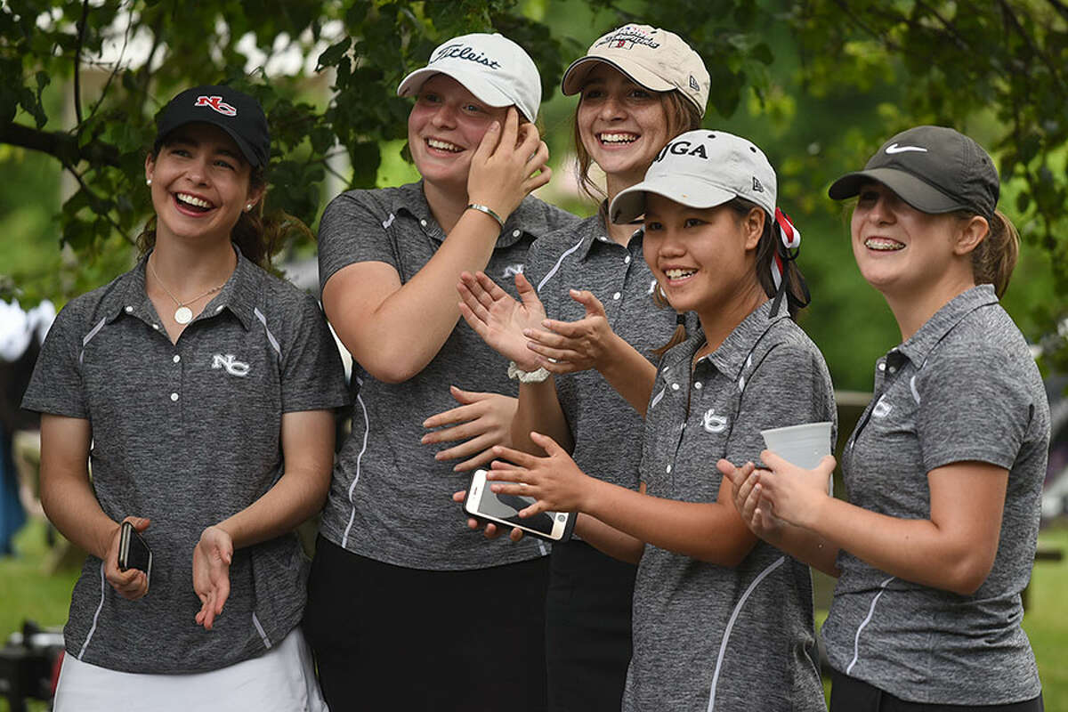 The New Canaan Rams, from left, Morgan Hibbert, Meghan Mitchell, Lauren Capone, Julia Bazata and Caroline Addeo, are all smiles after winning the 2018 FCIAC girls golf championship on Thursday. - Dave Stewart photo