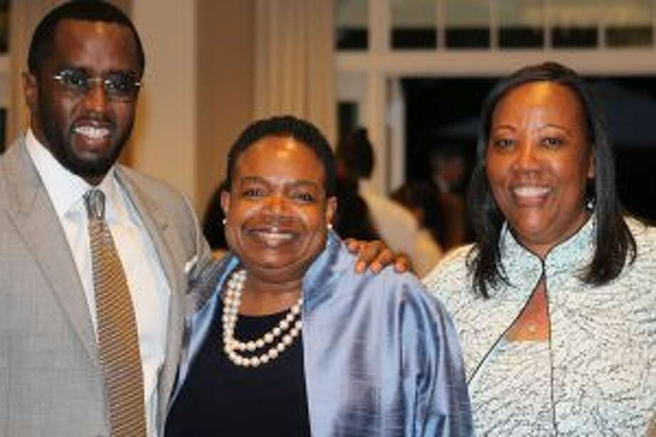 From left are Sean Combs who received Carver's annual Child of America award at the gala; Diana Napier, Carver Board president, and Novelette Peterkin.
